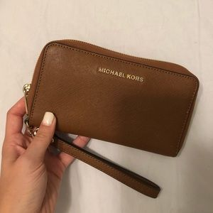 Micheal Kors brown leather wristlet/wallet